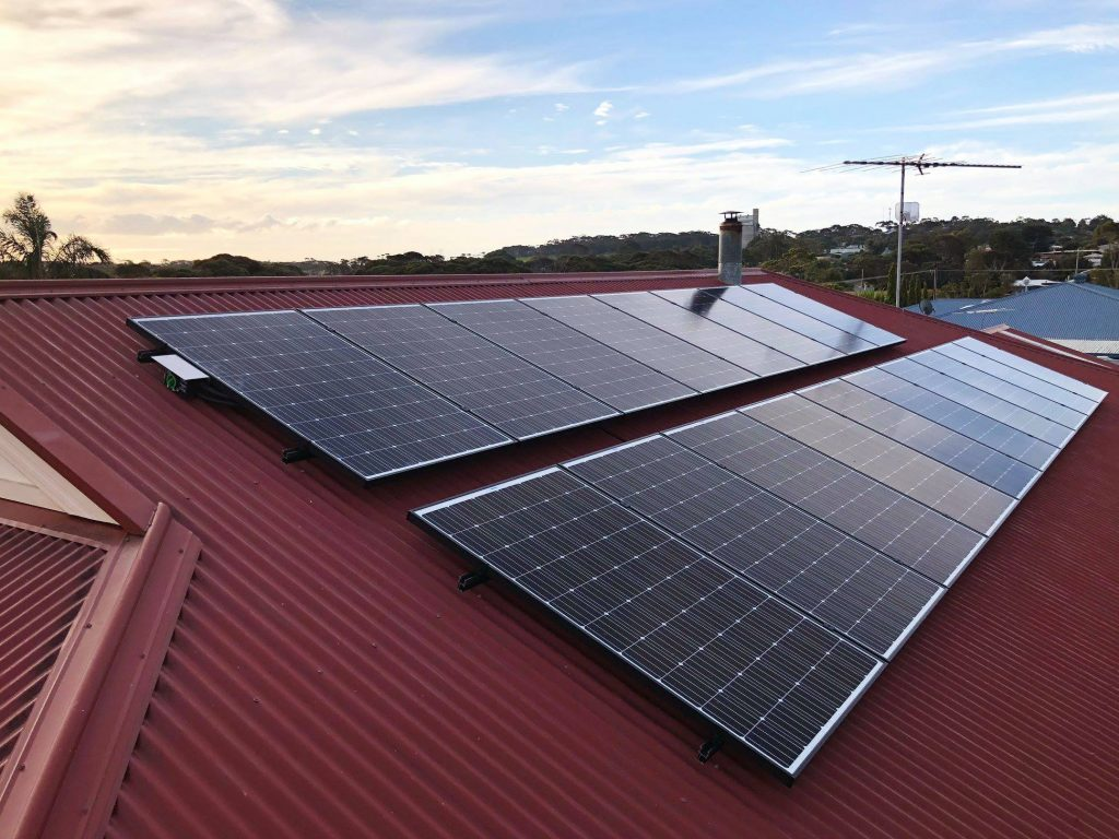 solar modules on red roof