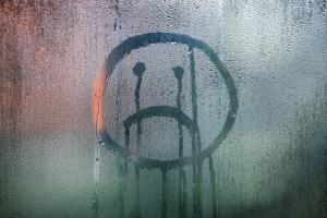 wet glass sad face